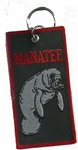 MANATEE KEY RING - Black Background with Manatee on it.